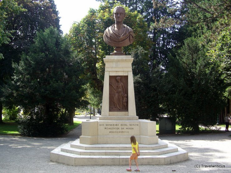 Small child in front of the huge bust