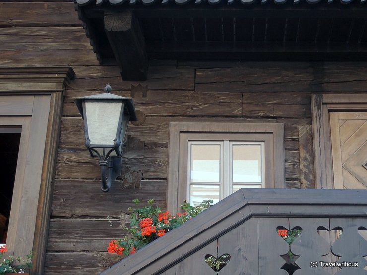 Wooden symbols at a building in Haus, Austria