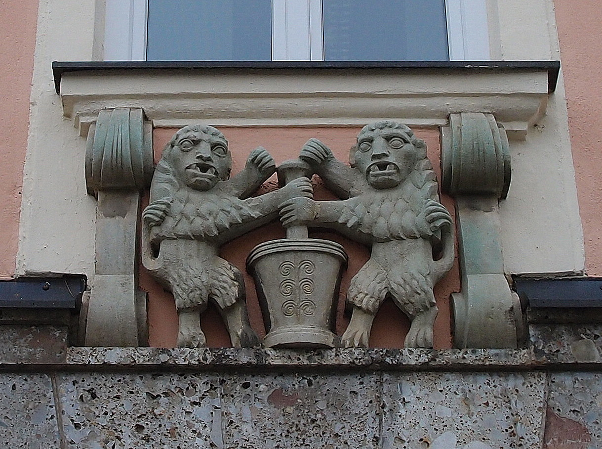 Two lions in a pharmacy house sign